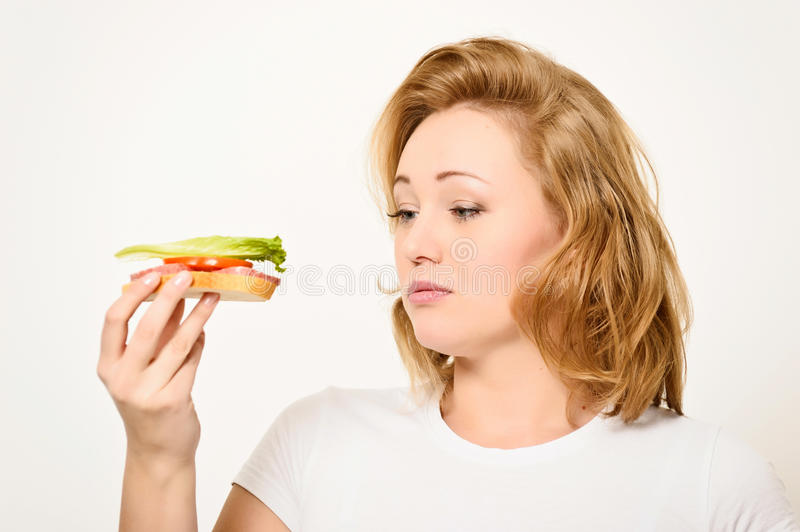 Woman with sandwich. The girl the blonde is going to eat a sandwich stock images