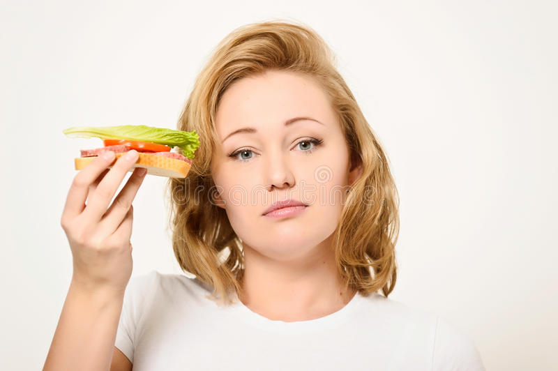 Woman with sandwich. The girl the blonde is going to eat a sandwich stock photos