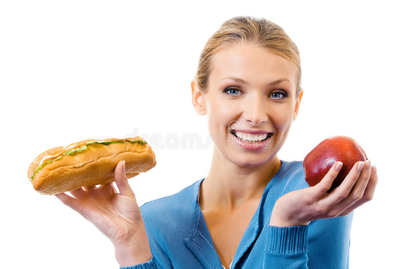 Woman with sandwich and apple royalty free stock image