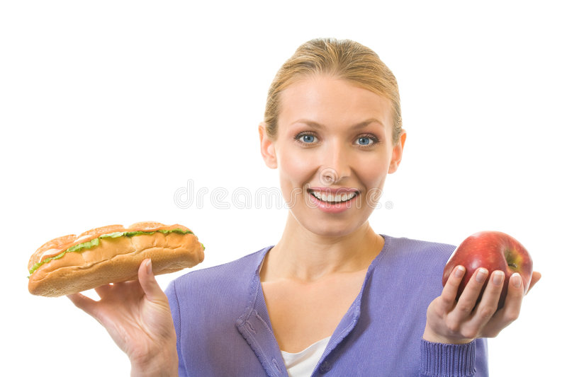 Woman with sandwich and apple. Isolated on white royalty free stock photos
