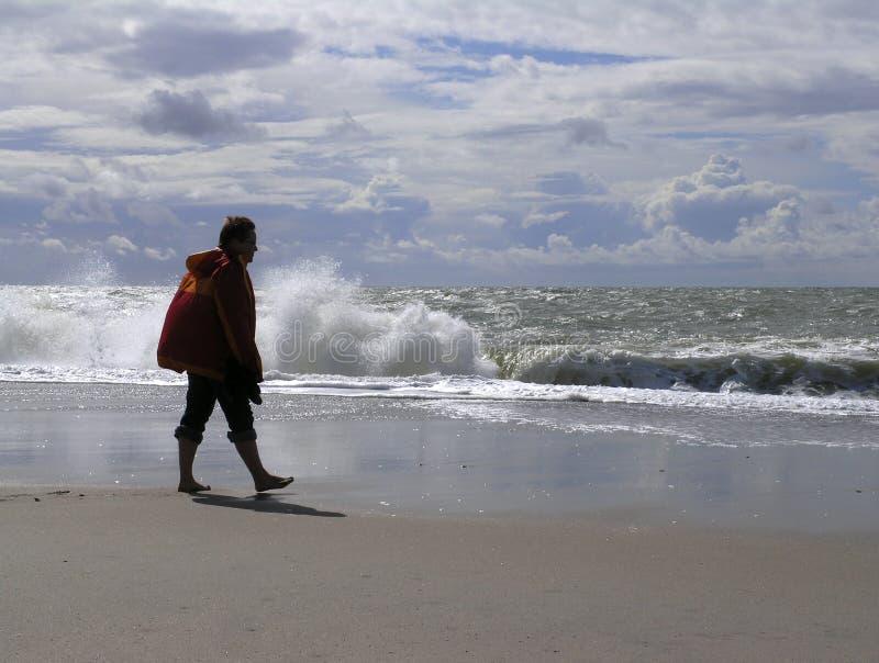 Woman on sandy beach stock photos