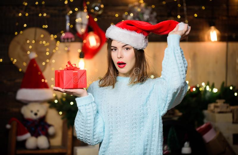 Woman santa claus hat on christmas eve. Lady adorable face celebrate christmas at home. Open her gift. Girl stylish stock images