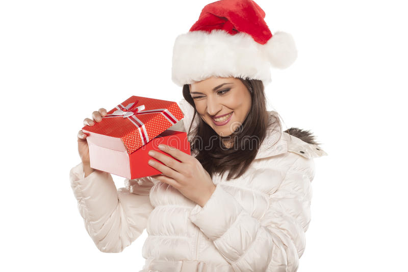 Woman with Santa Claus hat and a gift stock images