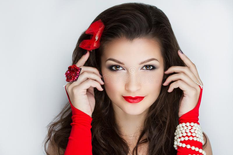 Woman santa girl. Young face closeup photo portrait. Beautiful girl wearing Christmas accessories. Pretty woman big eyes stylish make up, happy New Year party stock images