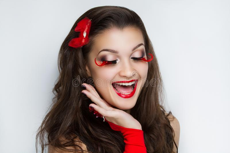 Woman santa girl. Young face closeup photo portrait. Beautiful girl wearing Christmas accessories. Pretty woman big eyes stylish make up, happy New Year party royalty free stock photography