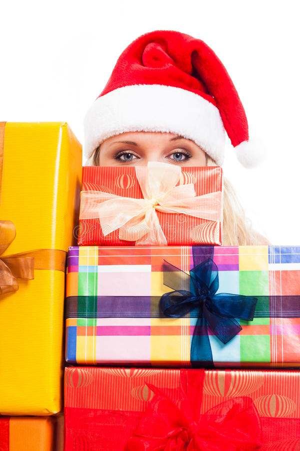 Woman in Santa hat and Christmas gifts