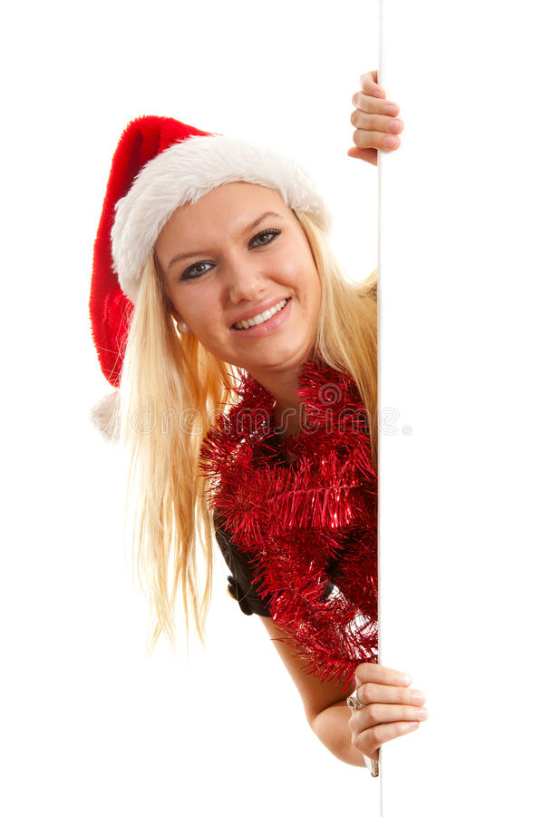 Woman With Santa Hat Holding Empty Board Stock Photo