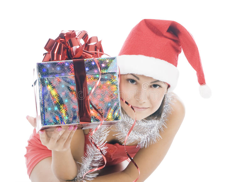 Woman in santa hat holding gift. Beautiful christmas woman in santa hat holding gift stock photo