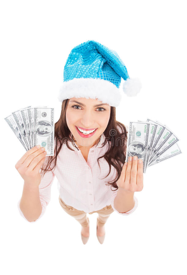 Download Woman In Santa Hat Holding Money Stock Photo - Image: 28484642