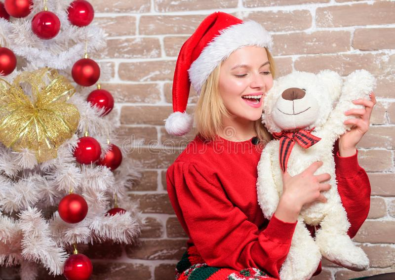 Woman santa hat hug soft toy bear. Best gift ever. Girl happy celebrate new year christmas. Receive teddy bear as gift. Wish you merry christmas. Top list best royalty free stock images