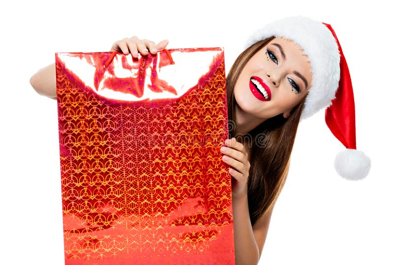 Woman in santa hat with shopping bags. royalty free stock image