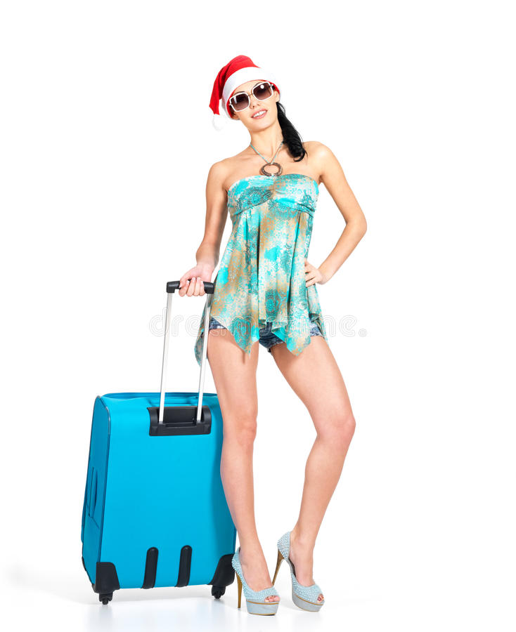Download Woman In Santa Hat  Standing With Travel Suitcase Stock Photo - Image: 28773956