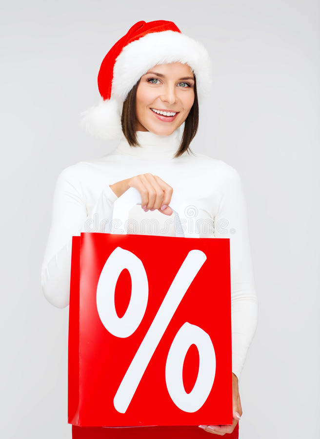 Download Woman In Santa Helper Hat With Shopping Bags Stock Photo - Image: 34395518