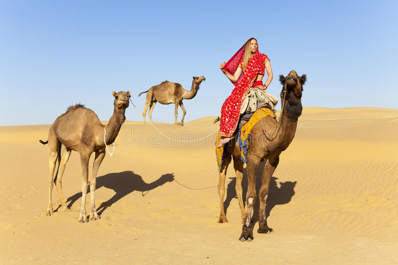Download Woman In Sari Riding A Camel. Stock Photo - Image: 25106220