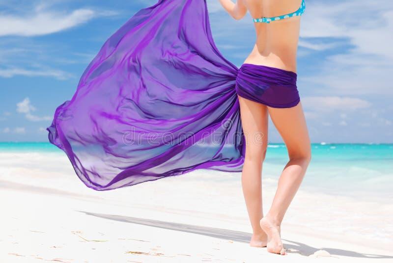 Woman with sarong stock image