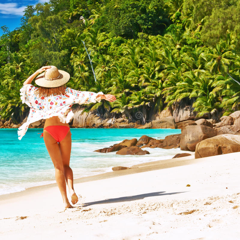 Woman with sarong on beach at Seychelles royalty free stock images