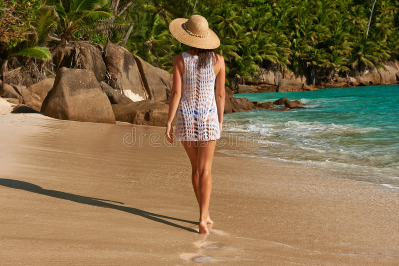 Woman with sarong on beach at Seychelles royalty free stock photography