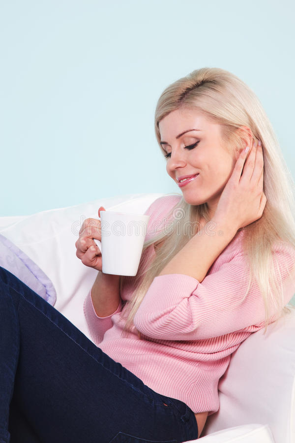 Woman sat with a mug of tea