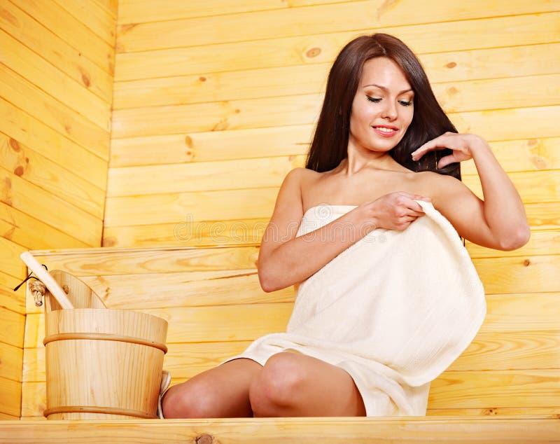 Woman with sauna equipment. royalty free stock photos