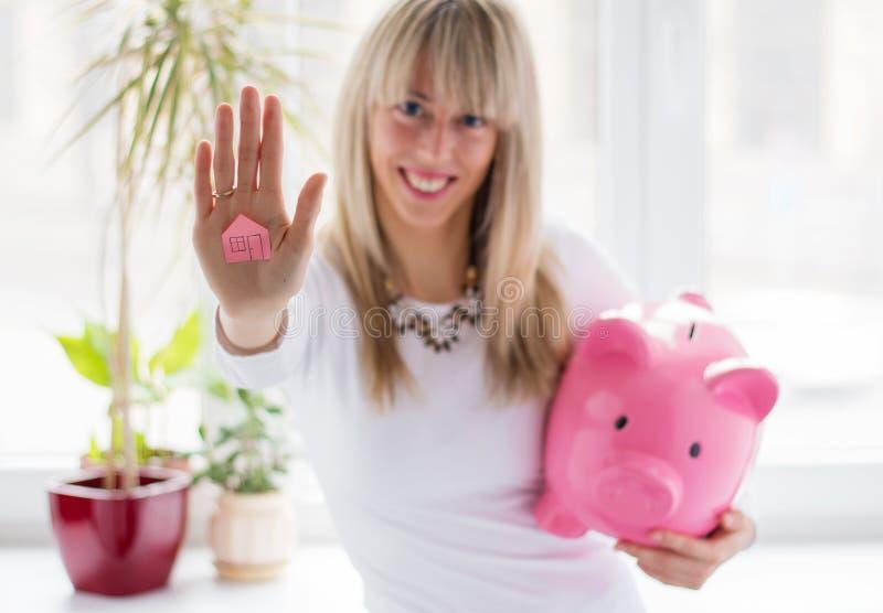 Woman saving money stock photos