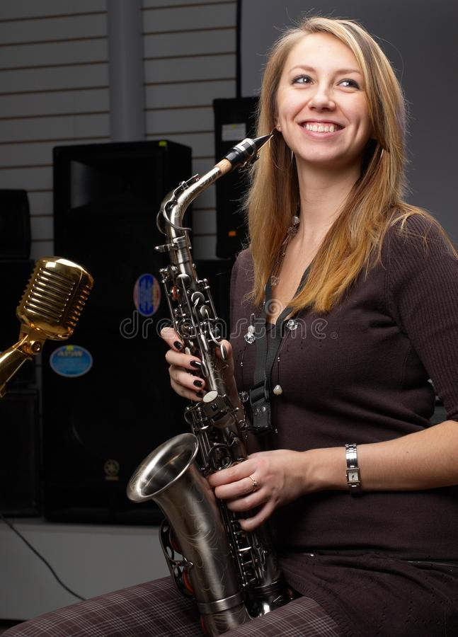 Woman with saxophone royalty free stock image