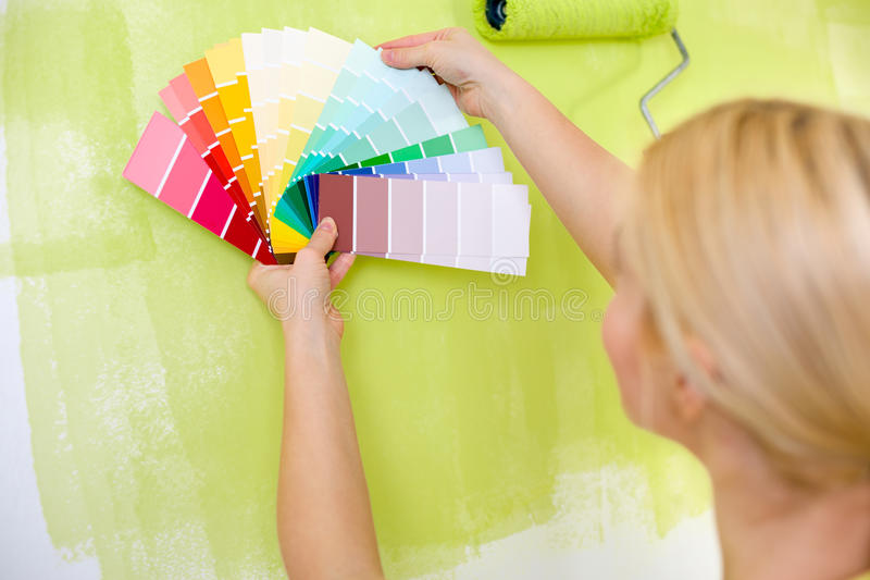 Woman with scale of paint swatches royalty free stock images