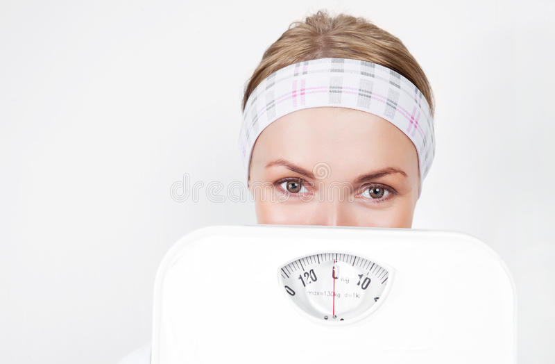 Woman with scales royalty free stock images