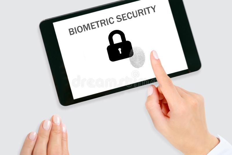Woman scanning fingerprint on screen and unlock digital tablet.  Cyber security concept. Home security system fingerprint royalty free stock photo