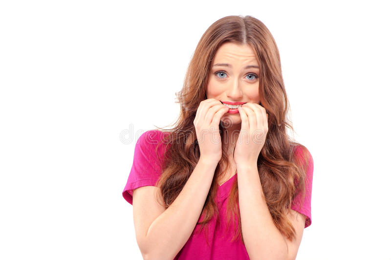 Woman scared and afraid with wide opened eyes royalty free stock photo