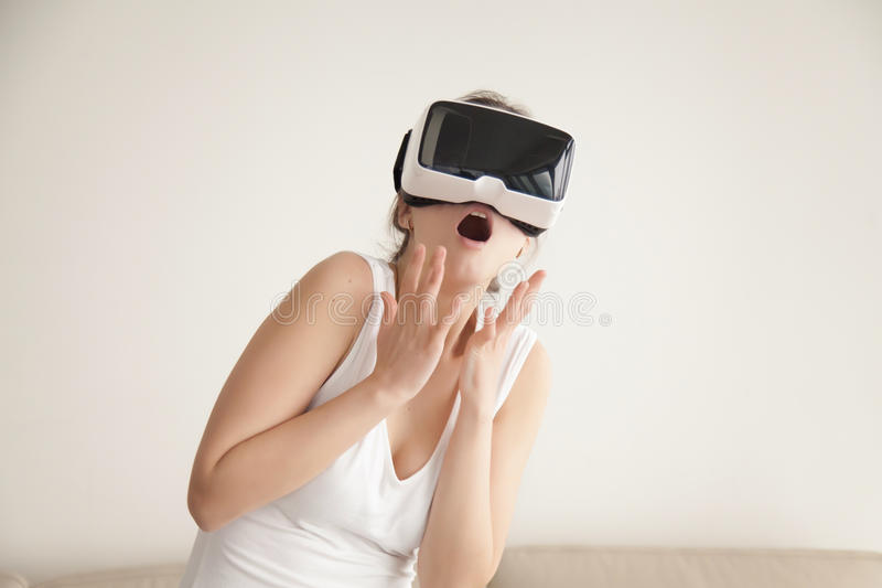 Woman scared with realistic virtual simulation stock photo