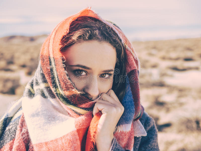 Woman with scarf over face stock photography