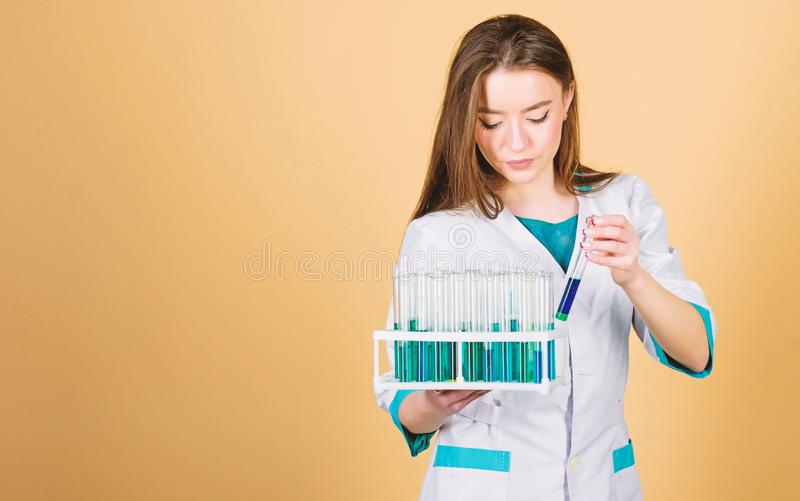 Woman scientist in lab. good results. woman doctor with testing tube and microscope, research. Biology school laboratory. Equipment. Scientist research and royalty free stock photo