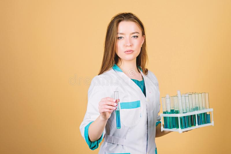 Woman scientist in lab. good results. woman doctor with testing tube and microscope, research. learning chemistry in. School laboratory. chemistry lab. Checking stock photos