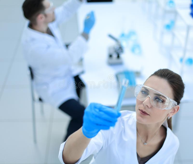 Woman scientist working in a modern laboratory royalty free stock image
