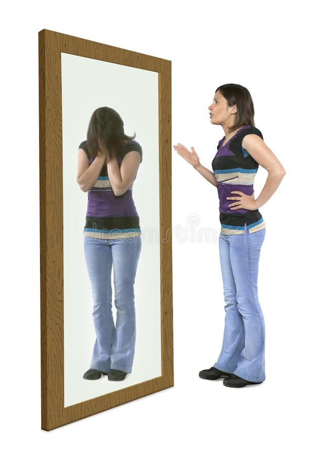 Woman scolding herself in a mirror royalty free stock photo