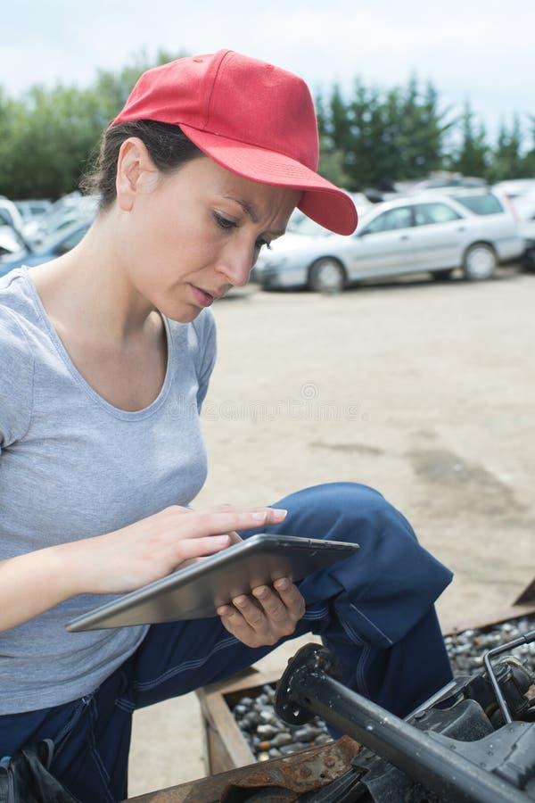 Woman scrap yard worker stock photography