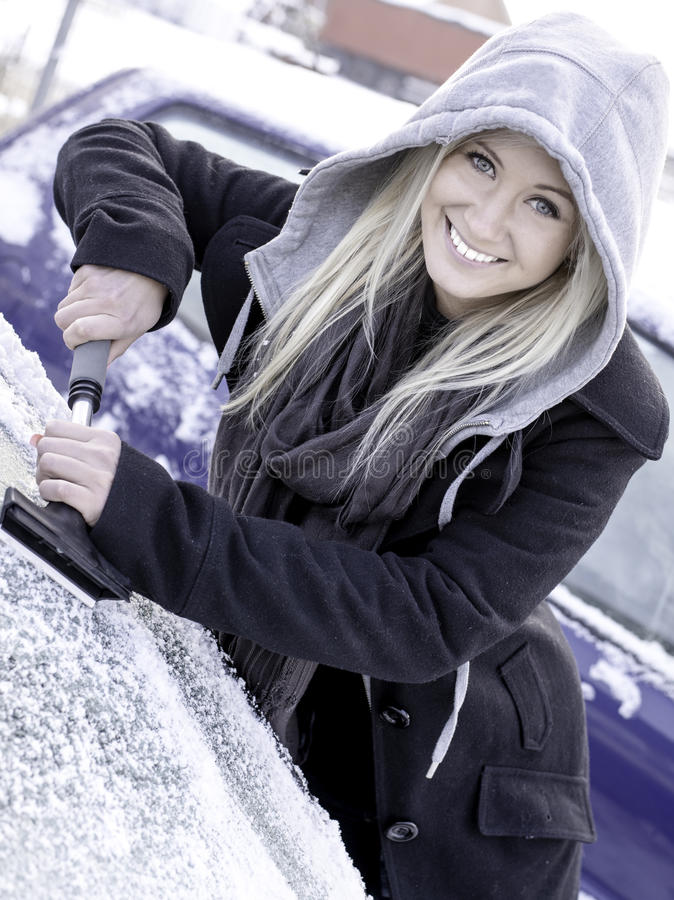 Woman scraping ice royalty free stock photography