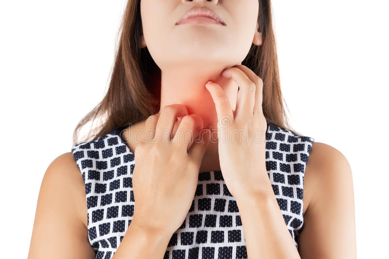 Woman scratching her itchy neck stock photos