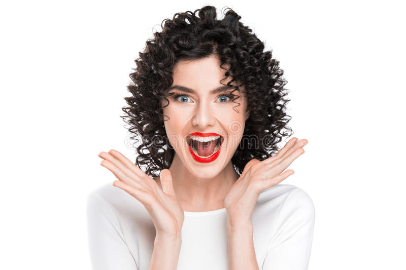 Woman screaming amazed in joy stock photography
