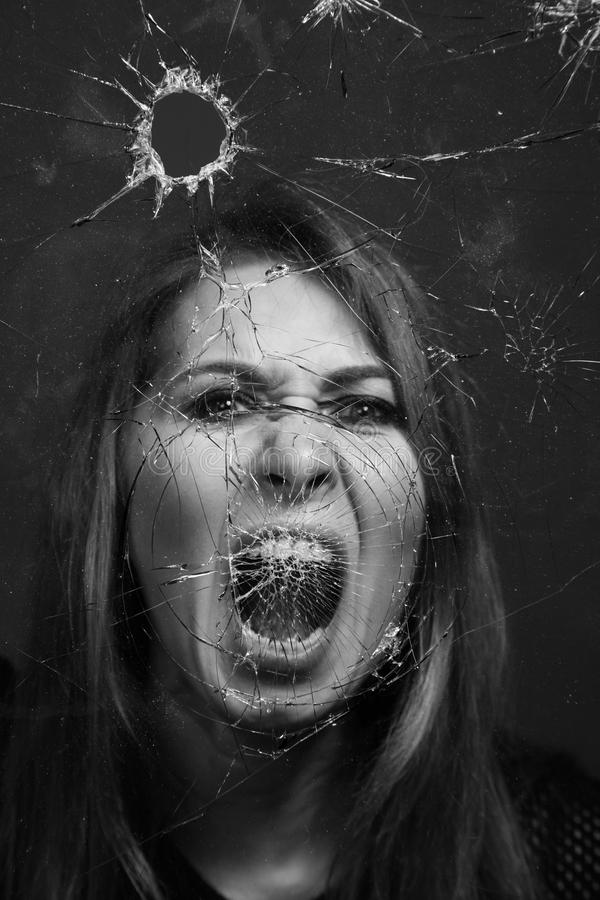 Download woman screaming through broken glass black and white stock image image of adult