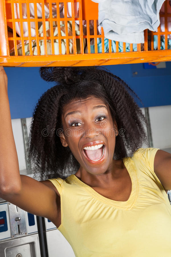 Woman Screaming Carrying Overloaded Basket Stock Images