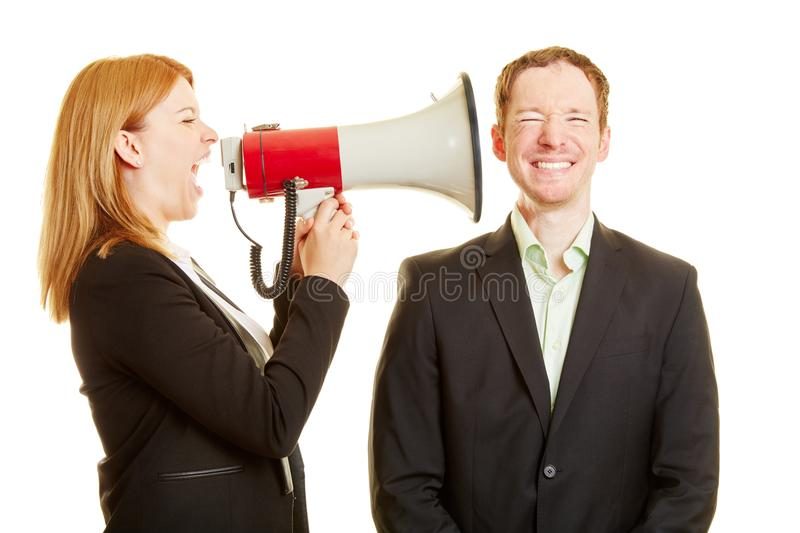 Woman screaming to a man with a megaphone royalty free stock photo
