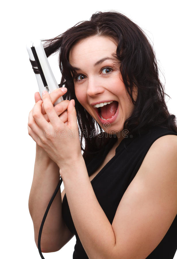 Woman Is Screaming While Using Hair Straightener Stock Images