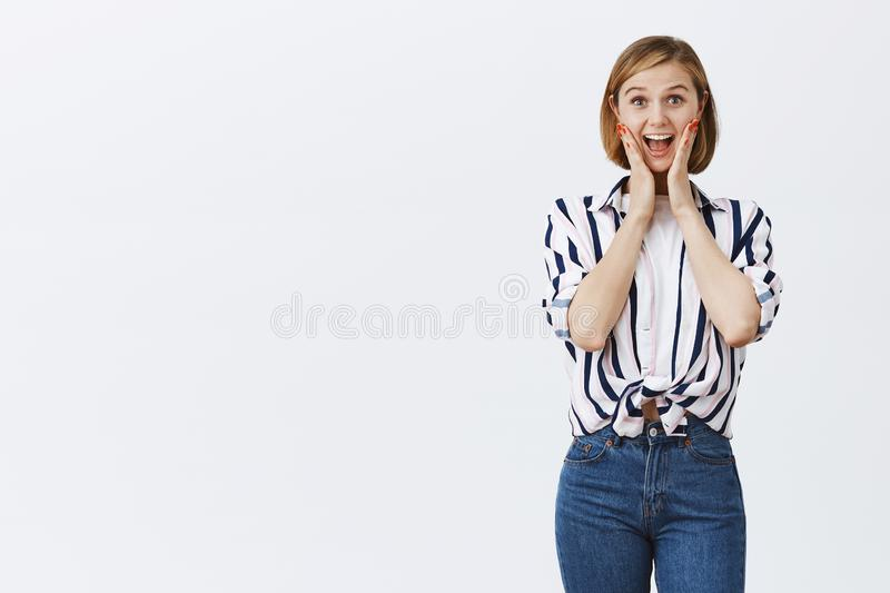 Woman screams from amusement and joy, being amazed. Portrait of attractive active and happy young female employee in royalty free stock photos