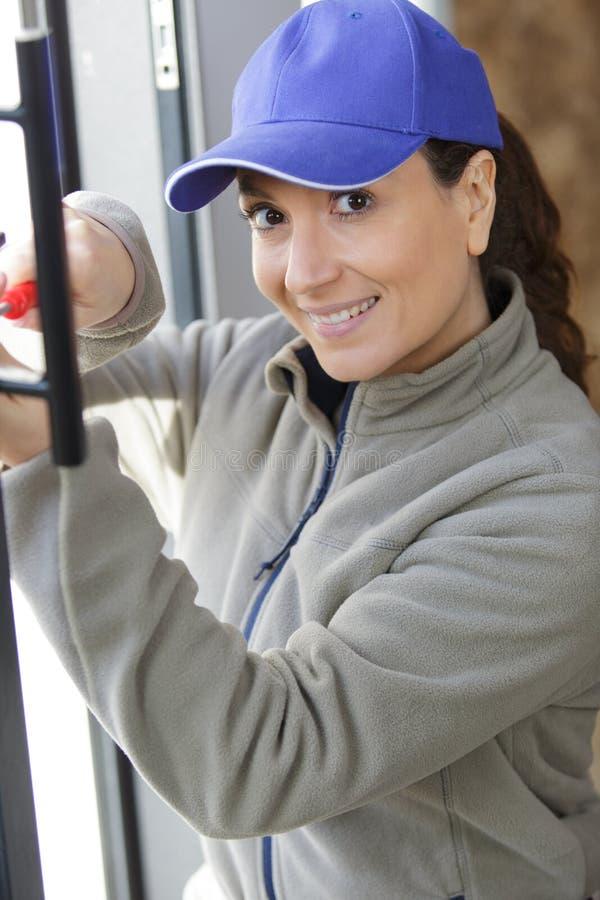 Woman screws frame stock photography