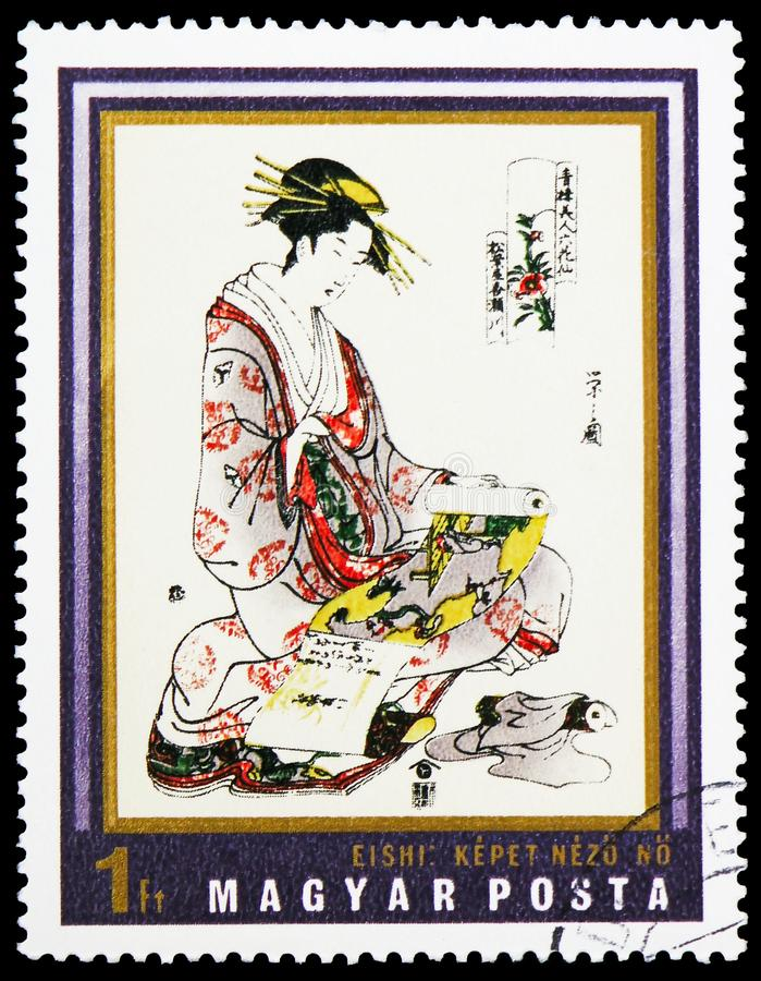 Woman with Scroll by Yeishi, Japan Colored Wood Engravings, Museum of East Asian Art serie, circa 1971. MOSCOW, RUSSIA - FEBRUARY 22, 2019: A stamp printed in royalty free stock photo