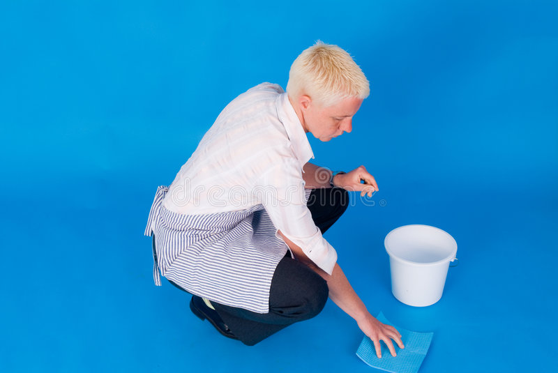 Woman scrubbing floor royalty free stock images