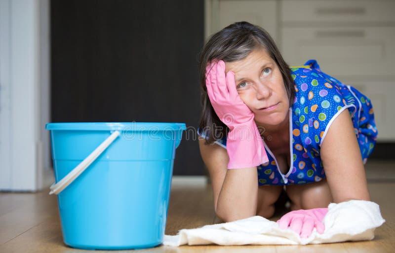 Woman scrubbing the floor stock image
