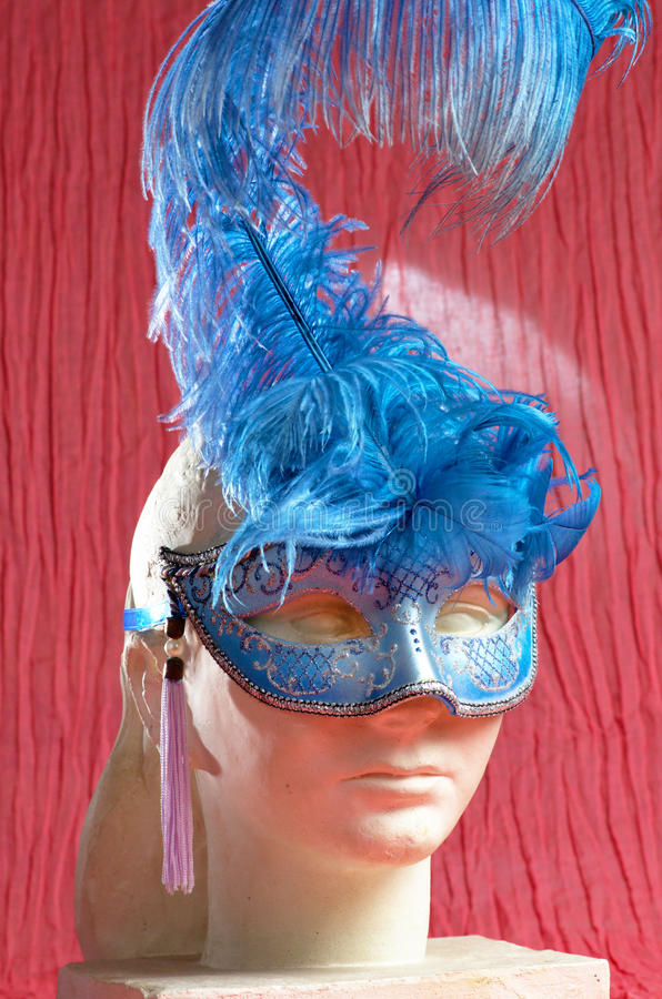 Woman sculpture with blue venetian mask royalty free stock photography