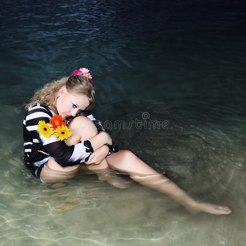 Woman in the sea royalty free stock photos